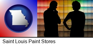 Saint Louis, Missouri - a couple looking at paint samples at a paint store